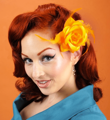 http://www.pinupgirlclothing.com/glitter-feather-rose-in-orange.html